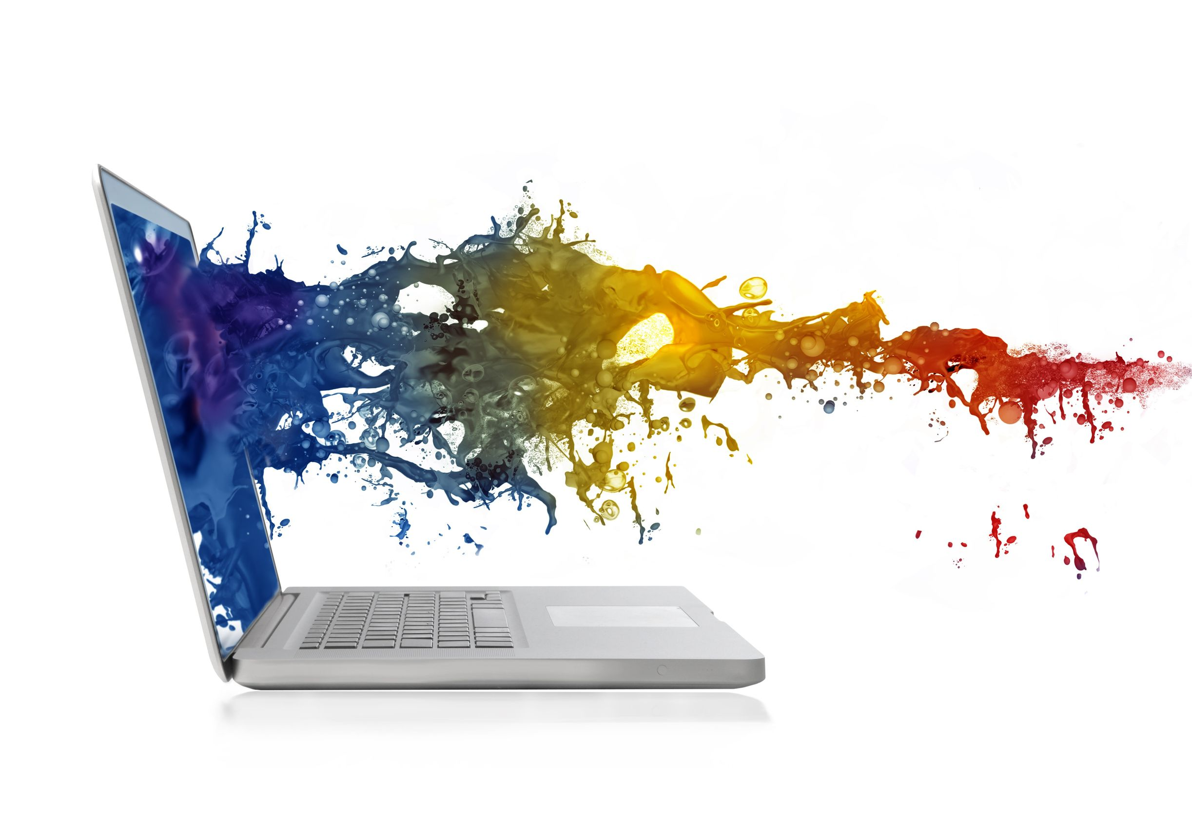 colored paint coming out of the screen of a laptop